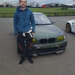 Guy with his race BMW